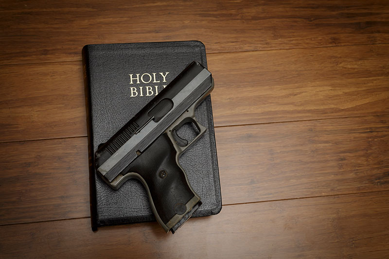 a gun and bible