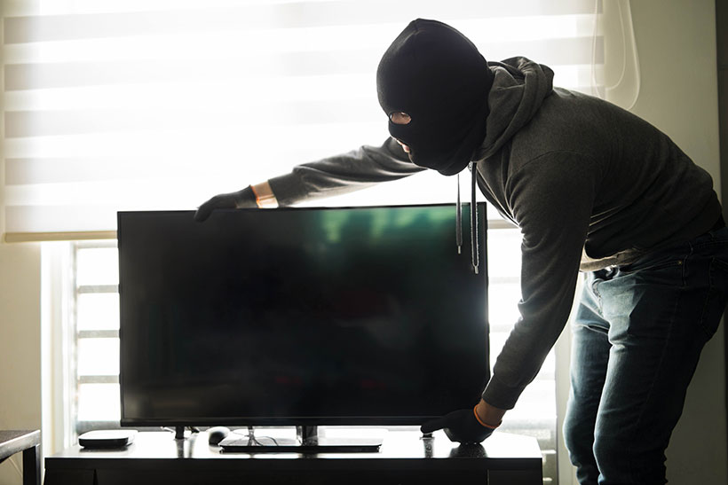 man stealing a TV